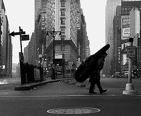 Dennis Stock: Bill Crow with his bass, Times Square, 1958