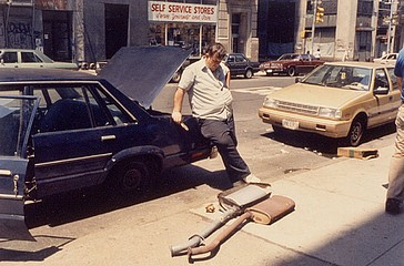 Elaine Mayes: Two Mufflers, Broadway, New York City, 1985