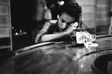 Eve Arnold: Bar Girl in a Brothel.  Havana, Cuba, 1954