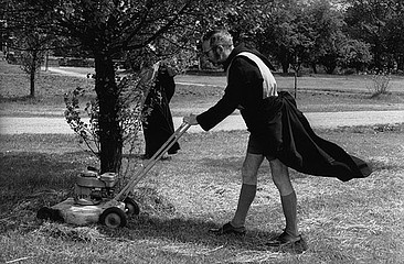 Eve Arnold: Priest Mowing the Lawn.  England, 1963