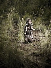 Joey L: Mursi Boy in Tall Grass