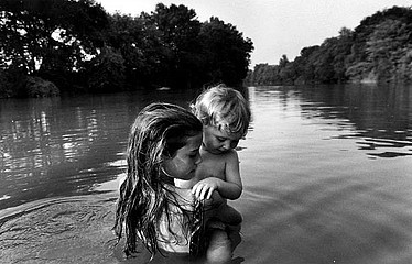 Larry Towell: Isaac's first swim, 1992