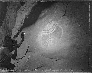 Mark Klett: David Photographing Baseball Man, Pictograph Along the San Juan River, 1990