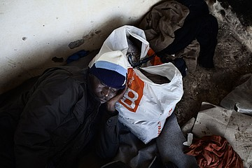 Michele Palazzi & Alessandro Penso: Migrant Resting After a Day of Work, Basilicata, Italy