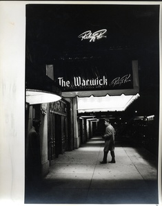 Alfred Wertheimer: Elvis Entering the Warwick Hotel, 1956